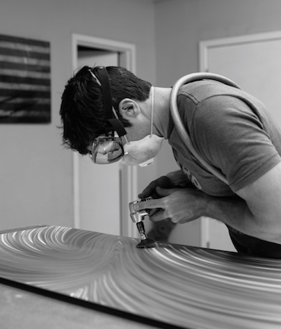 Nicholas Yust Making Aluminum Art
